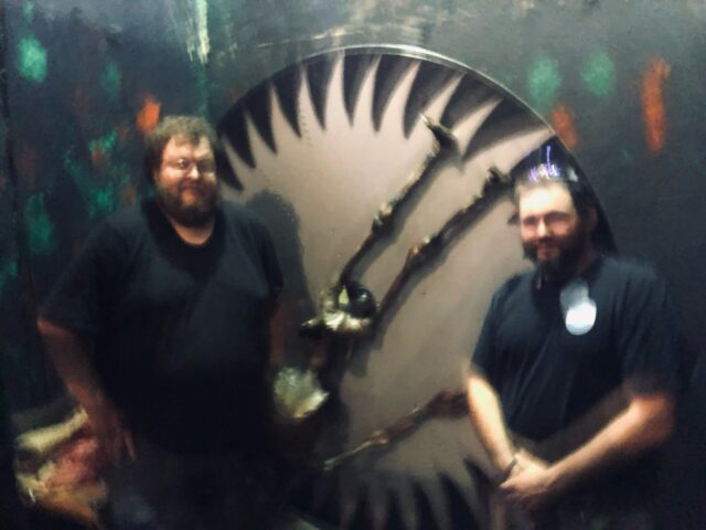 Two male DECC employees in haunted ship