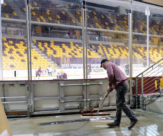 Jarid sweeping up excess slush